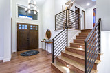 Chic entrance foyer with high ceiling and white walls. - 193890464