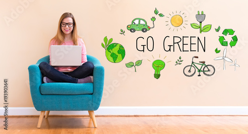 Foto op Canvas Wanddecoratie met eigen foto Go Green with young woman using her laptop in a chair