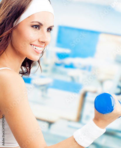 Aluminium Fitness Woman exercising with dumbbell, at fitness center