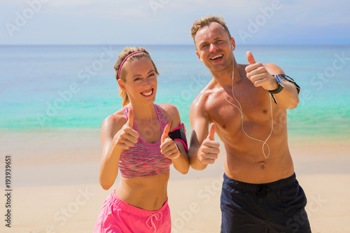 Fotobehang Fitness Happy fitness people on the beach