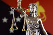 Quadro Symbol of law and justice with Papua New Guinea Flag. Close up.