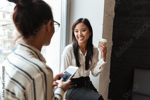 Businesswomen colleagues talking with each other