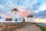 Famous view, Traditional windmills on the island Mykonos, The island of the winds, at sunrise, Greece - 193973233