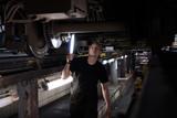 Mechanic using light to inspect a subway car - 193980053