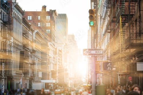 Foto op Aluminium New York Sunlight shines on people walking the streets of SoHo in New York City