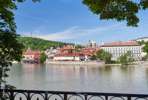 Staande foto Praag A riverside view of Vltava running through Prague with it's red
