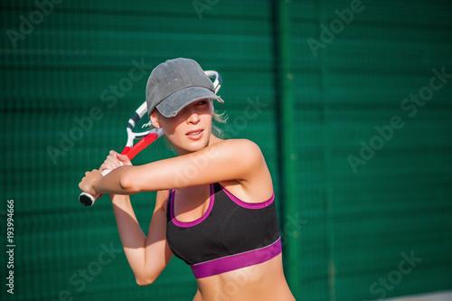 Fotobehang Tennis Woman wearing cap playing tennis