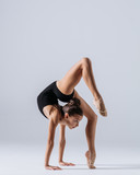 Young gymnast girl stretching and training - 194000012