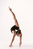 Young gymnast girl stretching and training - 194000065