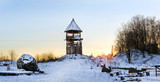 Wooden lookout tower stands on a snowy mountain. Winter landscape at sunset. Decorations of old Russian fortifications in Funny Nicholas Fortress - 194004004