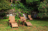 Wooden chairs for relaxing in a green garden