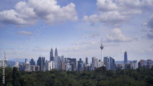 Foto op Aluminium New York Kuala Lumpur city sky line at day light with blue sky and heavy cloud.