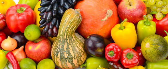 A set of fresh vegetables and fruits. Bright background.