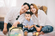 Quadro Happy Asian Family , Father and Mother Playing with Son in Living Room  - Family Concept