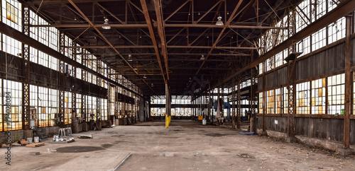 Fotobehang Oude verlaten gebouwen Broken windows in abandoned warehouse industrial space