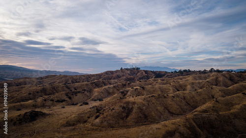 Plexiglas Diepbruine Aerial drone view of a landscape with desert and mountains