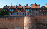 Walls and houses by the medieval Torun Castle in the old town of Torun, Poland - 194040626