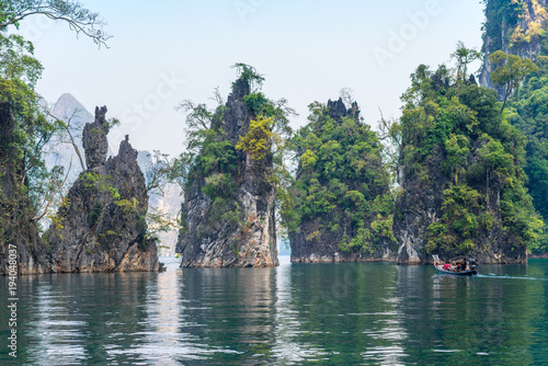 Foto op Plexiglas Bangkok Significant karst formations in the national park Khao Sok rise above the Cheow Lan Lake. Limestone rocks, jungle and karst determine the picture of the nature