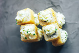Japanese sushi roll, hot and fried, tempura maki on concrete grey background © Anastassiya