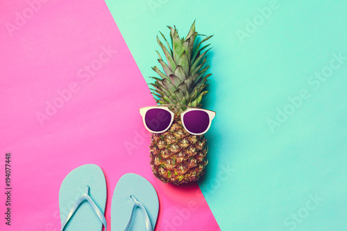 pineapple on colored paper with glasses - 194077448