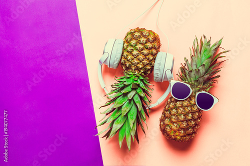 pineapple on colored paper with glasses - 194077477