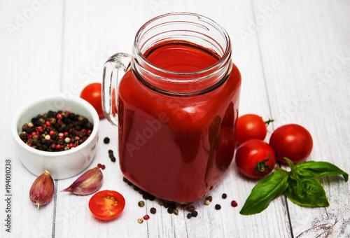 Jars with tomato juice © almaje