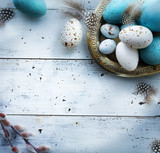 Easter background with Easter eggs on white table - 194086432