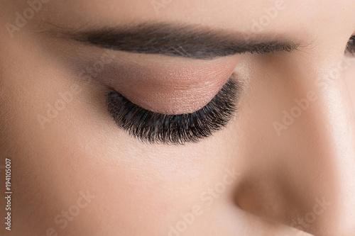 Closeup image of beautiful woman eye with fashion makeup and long eyelashes - 194105007