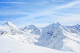 Mauntain glacier panoramic snow top panoramic view with blue cloudy sky