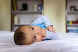 Eurasian baby on bed - 194114223