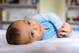 Eurasian baby on bed - 194114444