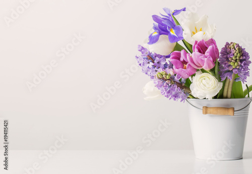 spring flowers in bucket on white  background