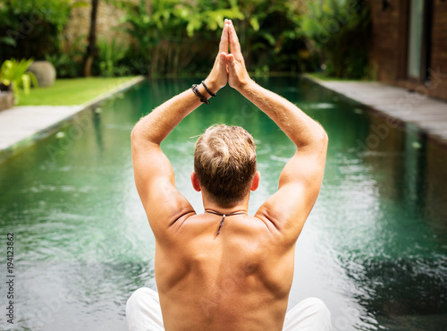 Foto op Canvas Zen Man practice yoga by the pool