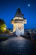 Leinwanddruck Bild - Graz clock tower at night, Styria, Austria