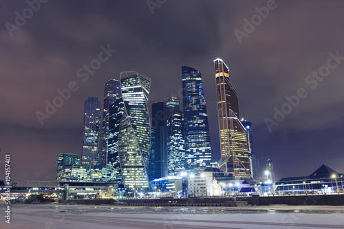 Tuinposter Moskou Moscow city night landscape. Night lights of big city. Skyscrapers in Moscow. Business center in Russia.