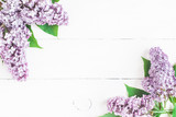 Flowers composition. Spring lilac flowers on white wooden background. Flat lay, top view, copy space - 194159253