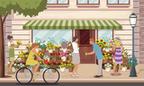 People in front of a colorful flower shop.