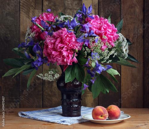 Fotobehang Iris Bouquet of garden flowers: peonies, irises.