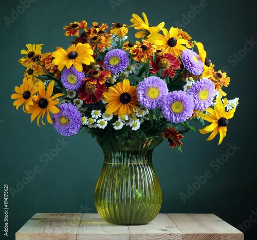 Garden flowers in a glass vase.