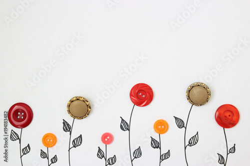 flowers from buttons on a white background. view from above. children's background - 194183482