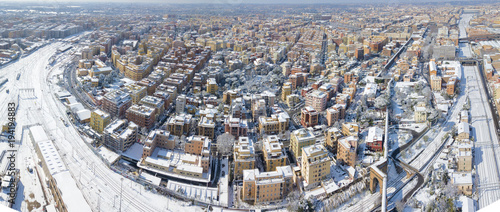 Foto op Canvas Rome Panoramic aerial view of a part of the city of Rome, capital of Italy, during the cold winter. The buildings and streets are unusually covered with snow and ice.