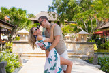 Romantic couple having fun on vacation in tropical resort