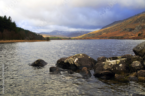 Foto op Canvas Grijs Storm clouds over moody Snowdon mountains across Lake Llyn Mymbyr