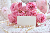 bunch of pink roses with blank card for greeting text - 194247219