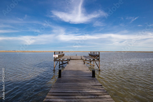 Aluminium Pier bridge to the sea beside mangrove jungle and blue sky