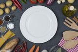 Food and cooking concept. Organic Ingredients, plate top view and copy space. - 194253407