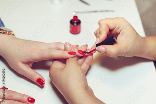 Foto op Plexiglas Manicure Woman doing manicure in beauty salon.