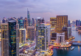 Spectacular view of a big modern city at night. Dubai Marina creek with skyscrapers. Scenic nighttime skyline..