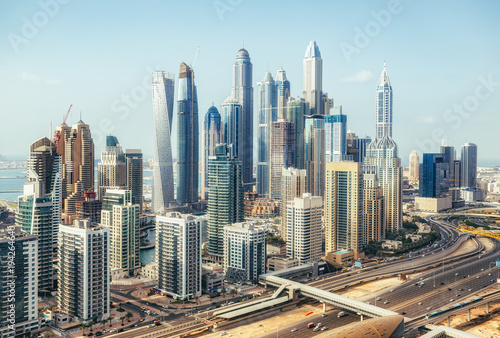 Tuinposter Dubai Scenic panoramic view of modern city architecture. Aerial daytime skyline of Dubai Marina, UAE, with skyscrapers and highways. Summer travel background.