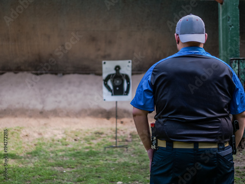 Fotobehang Palermo male with handgun in holster standby for shooting competion
